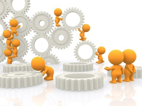 Gears being manipulated by small figures.